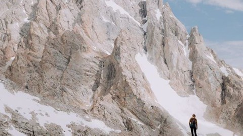 Adventurer @kyehalpin is always getting after it in the Tetons. Once you stand up there, you always want to go back. Epic photo by @roundtheworldgirl. #liveactivated #mountaineering #jhlife